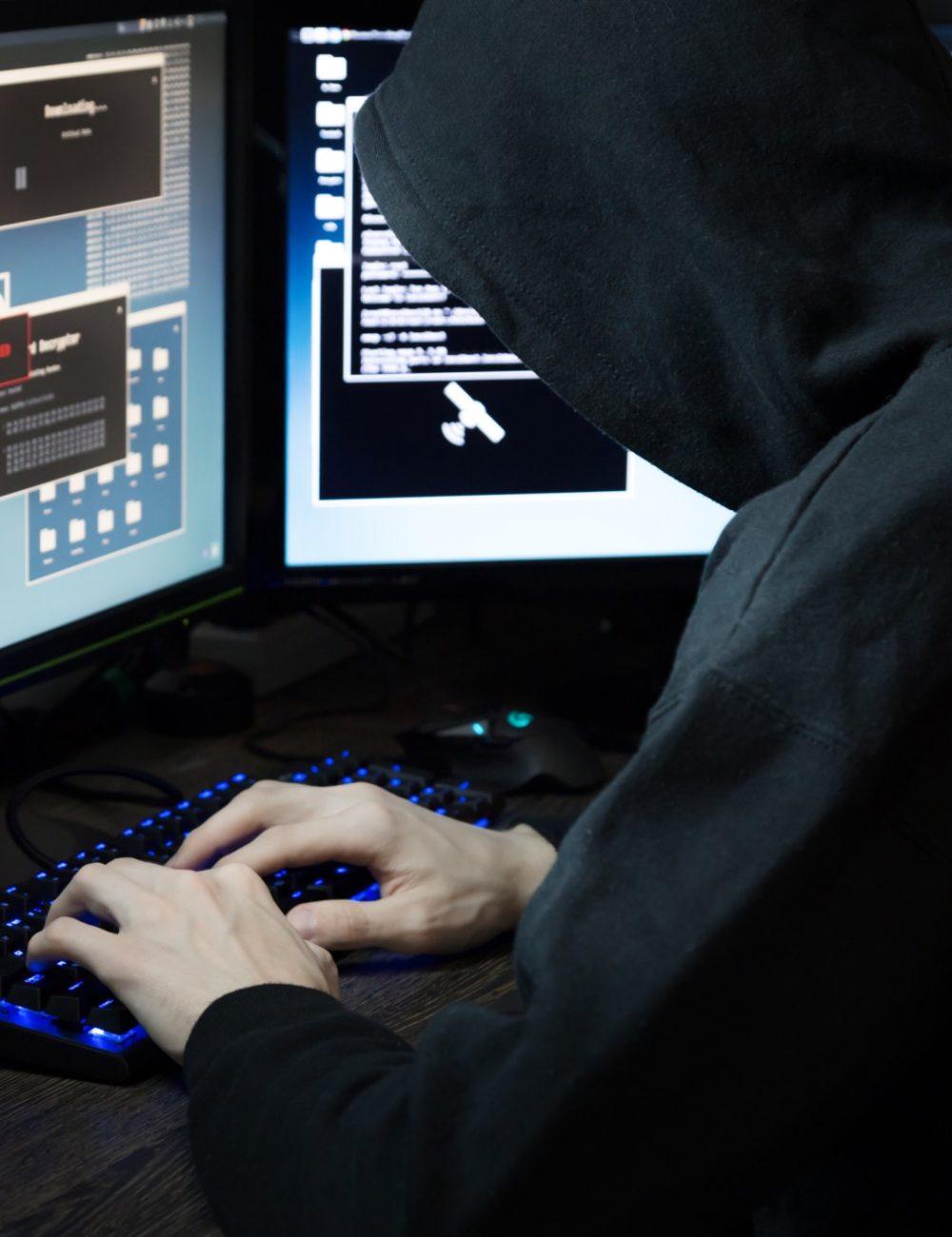 cyber-security-hack-business-financial-man-person-unrecognizable-criminal-thief-pc-electronics-screen_t20_zLxj8n